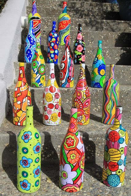 Painted wine bottles--talent is definitely at work here in these creative and brightly painted bottles. What fun it would be to have these standing around outside for a party or as a tablescape for a fun dinner party.
