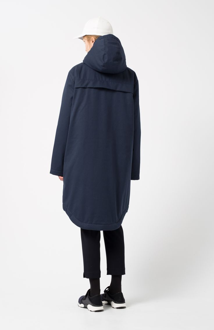 Arrox navy coat. Navy blue coat with two front patch pockets, hood drawstring cords, zip and press stud fastening. Heavy waterproof fabric, ideal for winter.