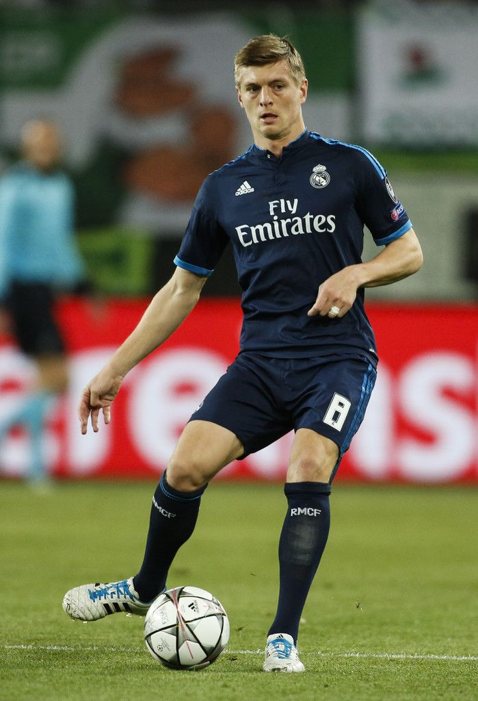 Real Madrid's German midfielder Toni Kroos plays a pass during the UEFA Champions league quarter-final, first leg football match between Wolfsburg and Real Madrid in Wolfsburg on April 6, 2016.