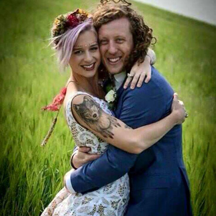 This stunning couple Britta & Ian. Britta wearing The House of Hats custom made silk flower bohemian headpiece