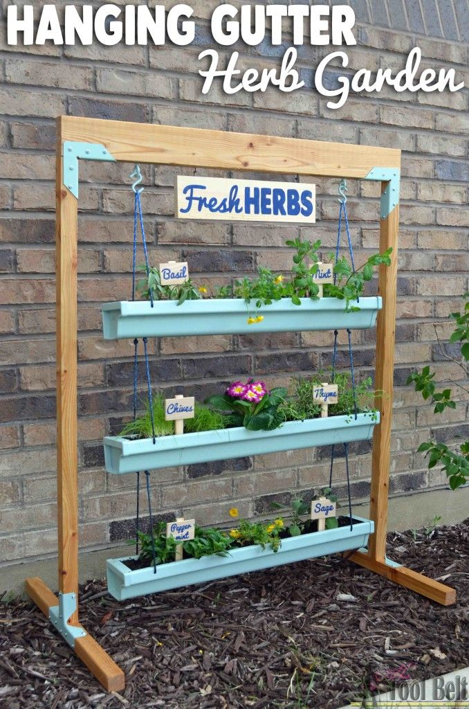Super easy fresh herb garden that I can move around. Free plans to build a hanging gutter planter and stand.
