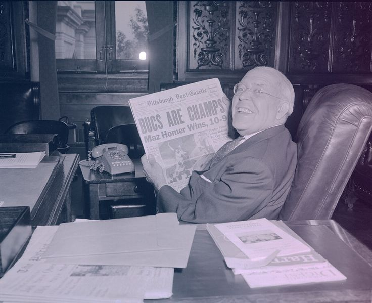 Gov. David L. Lawrence shows off a newspaper headline detailing the Pittsburgh…