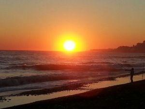 Sunset fishing on the beautiful Playazo beach, Nerja, Spain