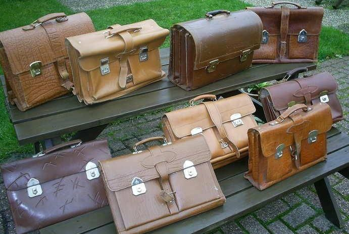 """""""School tassen"""" or School bags, made of genuine leather. I remember feeling so grown-up holding my brand new """"school tas"""", on my way to my first day in high school..."""