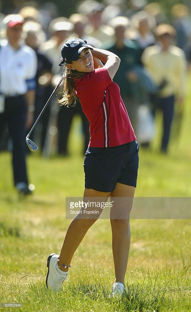Erica Blasberg of USA plays her approach shot on the 17th hole during her singles match against Danielle Masters of The Great Britain and Ireland team at the 2004 Curtis Cup Matches at Formby Golf Club on June 12, 2004 in Formby, England.