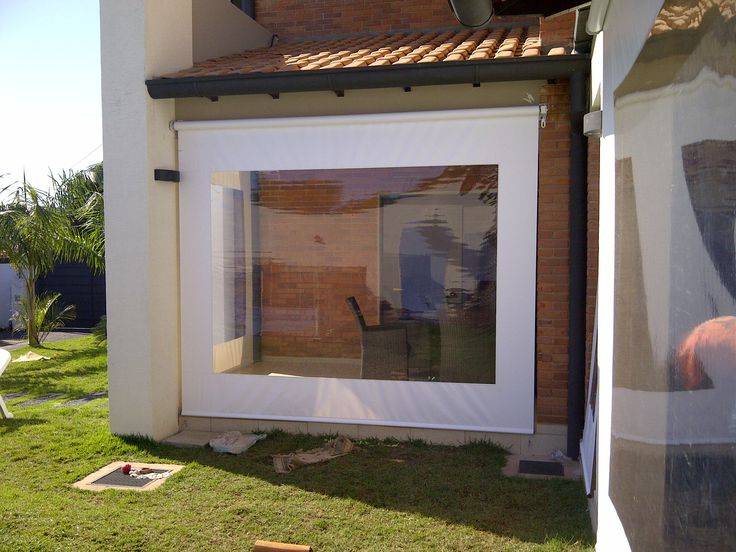 Vista exterior de cerramiento galer a con toldos for Cortinas espana