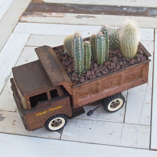 25 Inspiring Ideas: Repurposing Old Toys | Use a vintage/antique toy truck as a planter for an indoor cactus garden #DIY #upcycle #gogreen