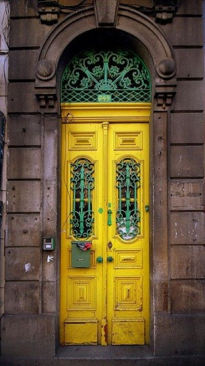 Yellow door with unique green ironwork.  http://stagetecture.com/2012/01/how-to-make-your-front-door-make-a-powerful-statement/