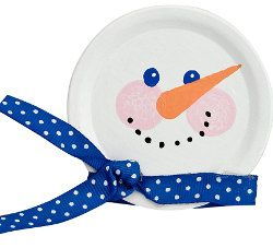 Canning Jar Lid Turned Snowman. Door ornament...Using paper plate, scrapbook papers & ribbon. Earmuffs with pompoms & pipe cleaners.