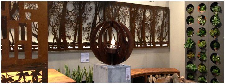 Decoration + Design 2013 installation by Entanglements metal art, featuring our laser cut steel The Murray panels, The Zen ethanol fire burner, and freestanding vertical wall garden.