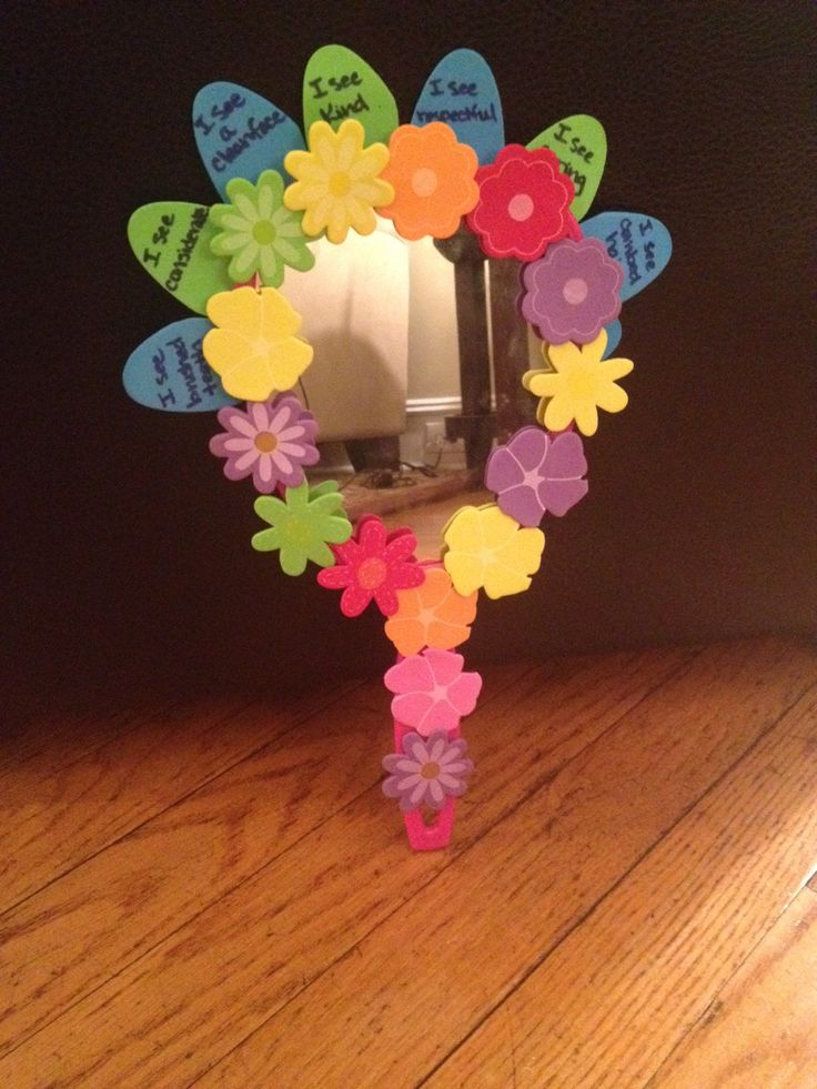 The girls created this mirror to earn their Purple Petal -- Respect Myself and Others. I got the mirrors at the Dollar Store and the foam flowers and stickers at A.C. Moore.