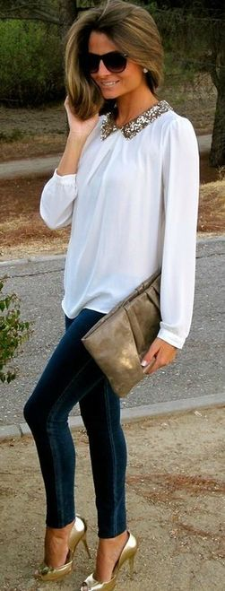 Skinny jeans, white shirt with jeweled collar, and metallic pumps.