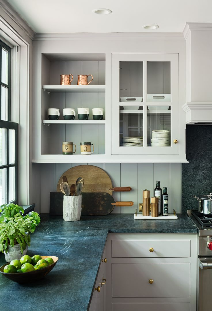 Modern Farmhouse Reno - soapstone counters with paneled splash that continues into cabinet backs above