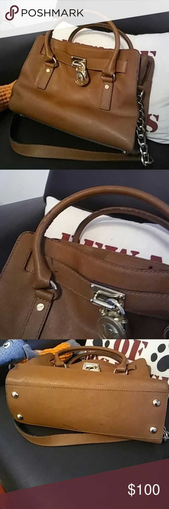 Michael Kors handbag Luggage color beautiful medium size bag. Original. Corners an leather perfect. Tarnish in lock. Just a couple of rubber marks around the bag from been stored. It can be cleaned or removed but I prefer someone else to do that. Inside light make up staining at bottom.  Open to reasonable offers. Michael Kors Bags Crossbody Bags