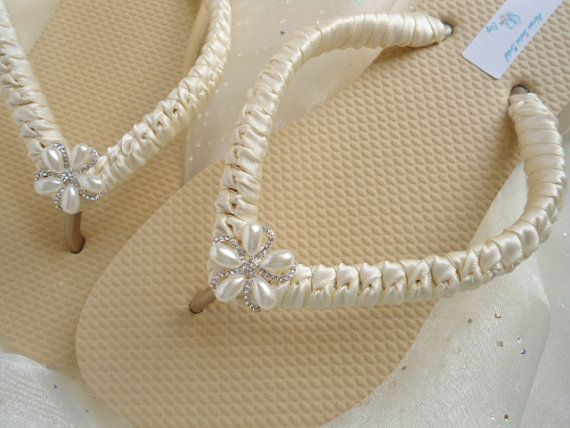 Nude flip flops decorated with ivory satin ribbon and stunning bling!