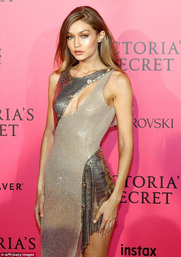 Shimmer: Gigi, 21, opted for a metallic gown which was slashed up the thigh and across the...