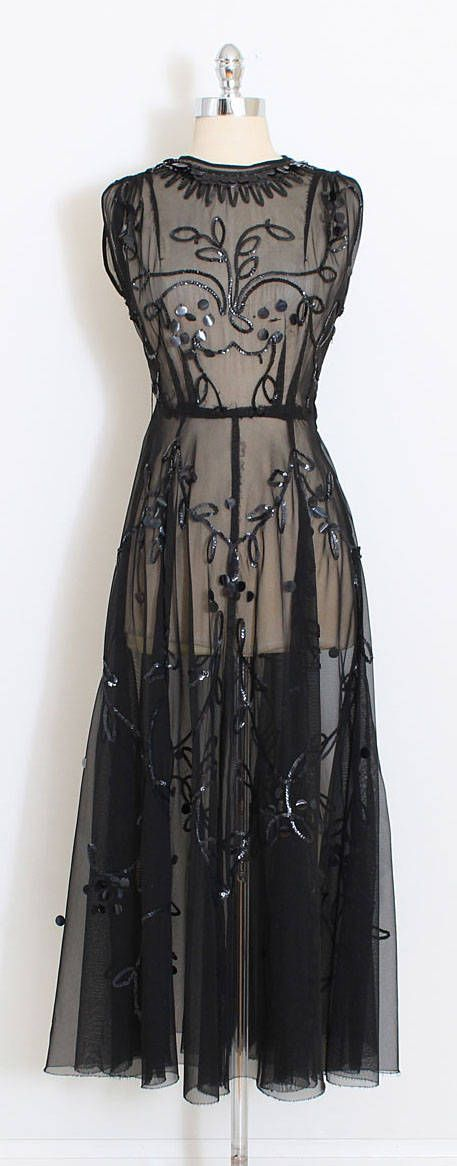 ➳ vintage 1940s dress and slip  * sheer black mesh * beautiful shiny sequins * metal side zipper dress * matching separate acetate slip with metal side zipper pellon lined hem  condition   excellent fits like xs/s  DRESS length 54 bodice 17 bust up to 38 waist 24-26 SLIP length 48 bodice 15 bust 34 waist 24  ➳ shop http://www.etsy.com/shop/millstreetvintage?ref=si_shop  ➳ shop policies http://www.etsy.com/shop/millstreetvintage/policy  t...