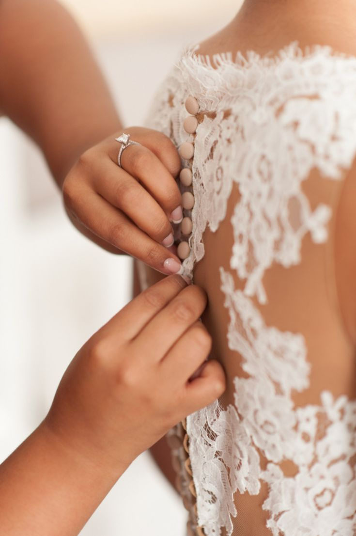 Our passion is to photograph little details. Capture from destination wedding in amazing Santorini, Greece. See her story See more here: http://photographergreece.com/en/photography/wedding-stories/842-elegant-wedding-at-venetsanos-winery