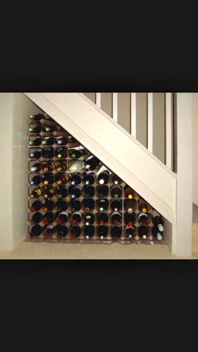 Under the stairs ideas - using ikea shelves and dividers to create an under stairs wine cellar closet. Entry on back, not side.