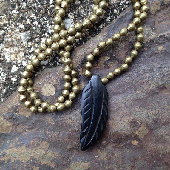 raven. carved bone feather necklace. spirit animal series.