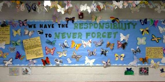 Really want to do this! Eighth-graders created butterflies that are decorating a bulletin board at Thomas Jefferson Middle School after reading 'I Never Saw Another Butterfly' as part of their study of the Holocaust.