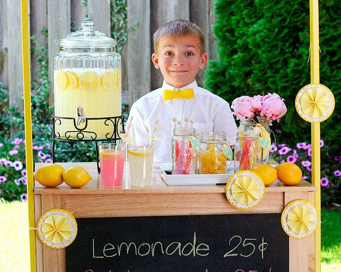 """Nothing says """"summertime"""" like a lemonade stand! This is a great DIY activity for kids or a unique way to dress up any outdoor party you have this season. Click in to learn how to create your own."""