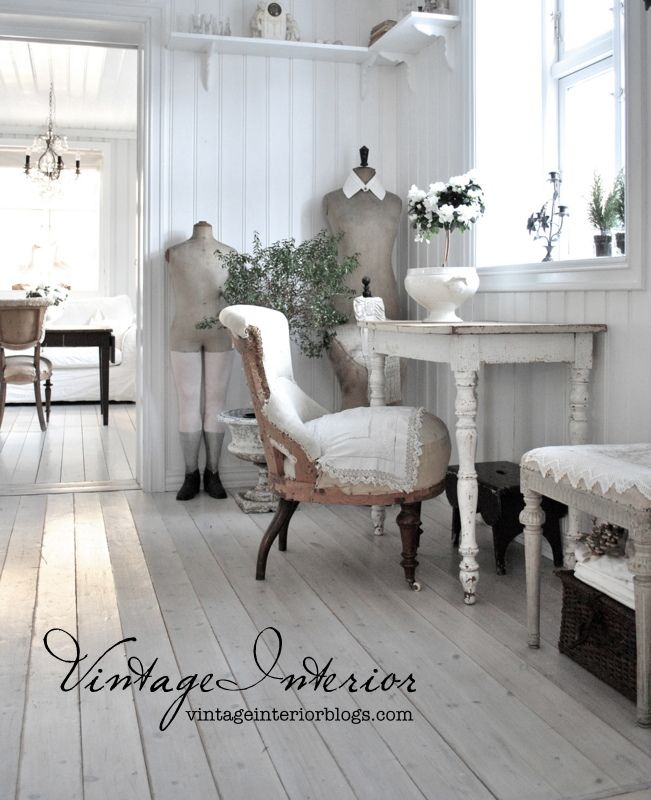 Grey hardwood floors compliment any shabby chic interior!