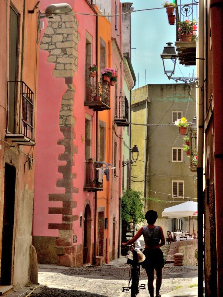 The historic centre of the Bosa town - Sardinia, the Sa Costa district, is an intriguing maze of medieval streets, stone staircases and terraces of tall houses painted in bright or pastel colours