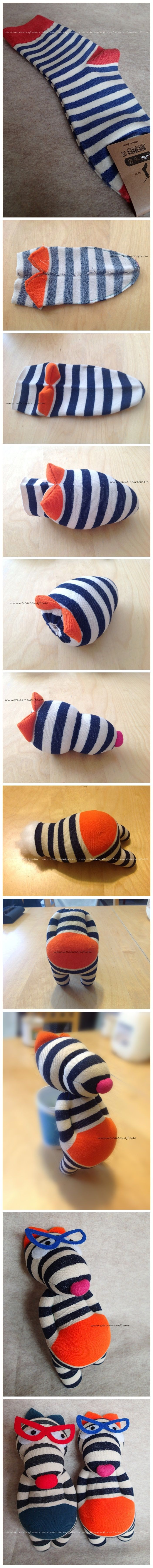 An ordinary stripes socks turned into a wolf doll.^^ Made by  - Melanie Park