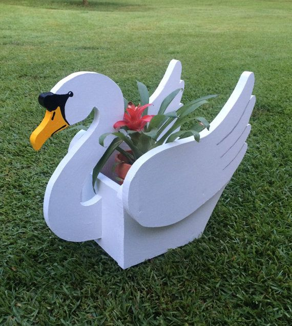 Beautiful Handmade Wooden Swan Planter. 15 long 13 High. Holds a 5 pot. Nailed, Screwed and Glued together. Built very well and sturdy. Covered with lacquer for protection. Plant not included