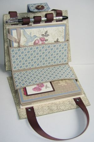 What a lovely thing to have!!!  A  place to store those fabulous cards you have made, and a place to always find the card you need- NOW!  Card purse with tutorial