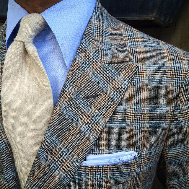Grey glen plaid jacket, light blue shirt, beige tie