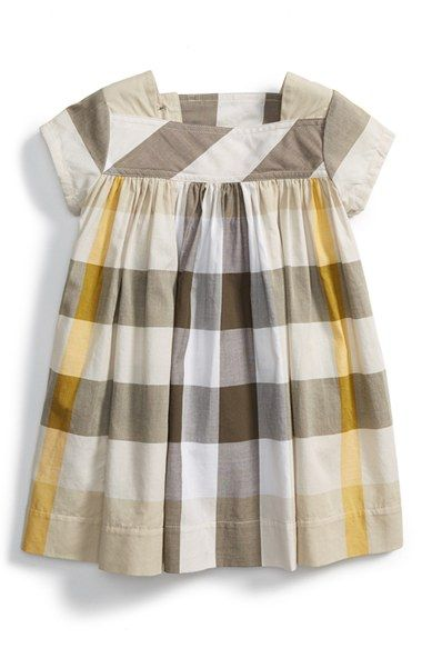 Free shipping and returns on Burberry Button Tab Check Cotton Dress (Toddler Girls) at Nordstrom.com. A button-tab closure highlights the gathered Empire waist of an airy cotton dress finished with cap sleeves.