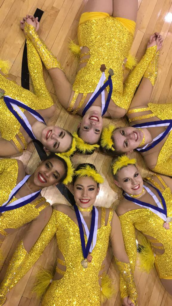 We LOVE these bright and yellow showgirl inspired custom dance costumes from Ashwaubenon Dance Team! Read more on their spotlight!  #dance #danceteam #showgirl #vegas #dancecostume #dancewear #dancecompetition