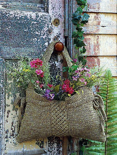 Planted handbag. I've seen some bags like this at Goodwill. May have to give it a try.