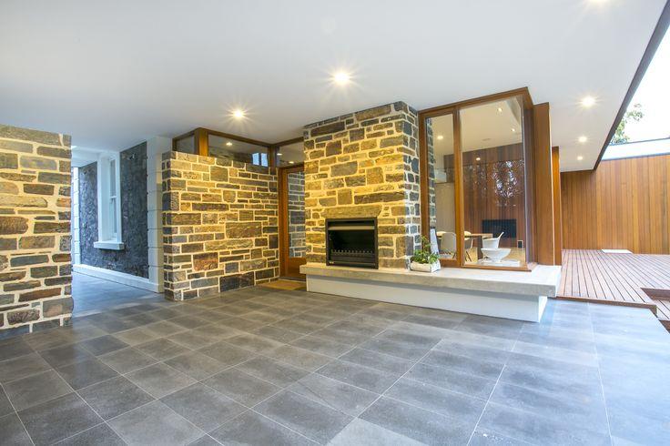 Outdoor fireplace, stone clad, alfresco living, concrete feature shelving