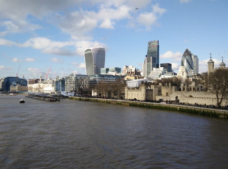 The City of London from the middle of Tower Bridge in the Winter sunshine.