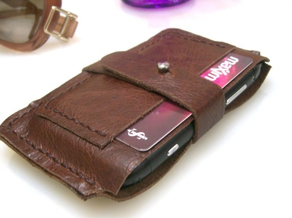 @Jessica DeYoung: Horizontal Handmade Leather iPhone 2G/3G/4G Pouch / Wallet / Card Holder - Rustic Brown-UNIQUE. I know you aren't a wallet or purse girl so this is pretty cool! :)