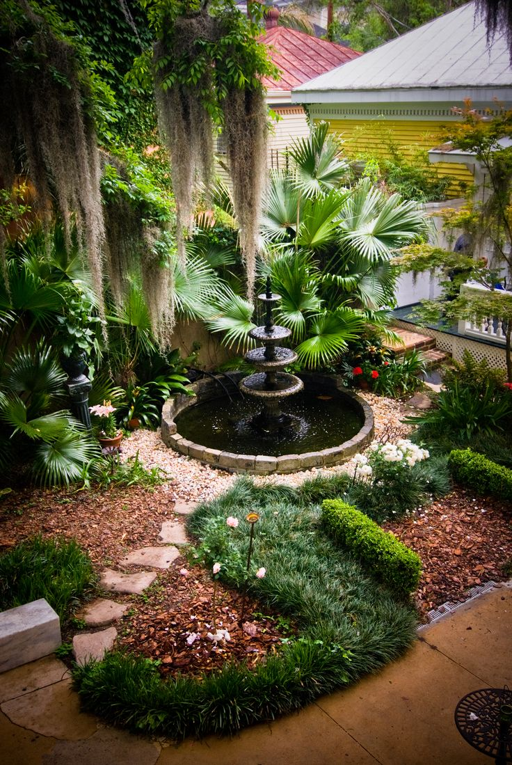 love this water fountain w/gravel, fir fiber mulch and easy maintenance shrubs