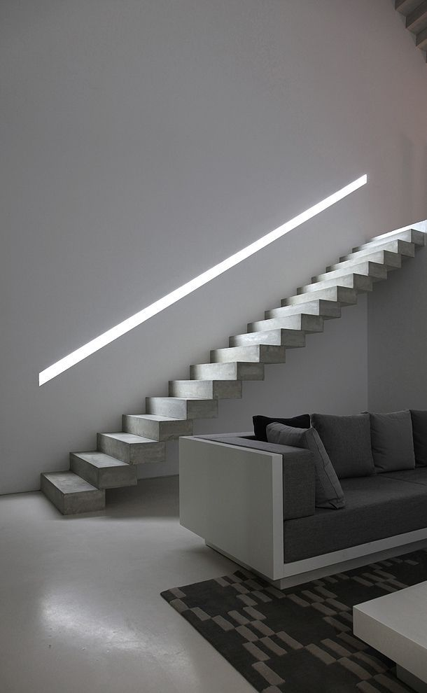I like the lighting within the wall integrated banister. Also a very nice sofa. House in Ontinyet by Borja Garcia.