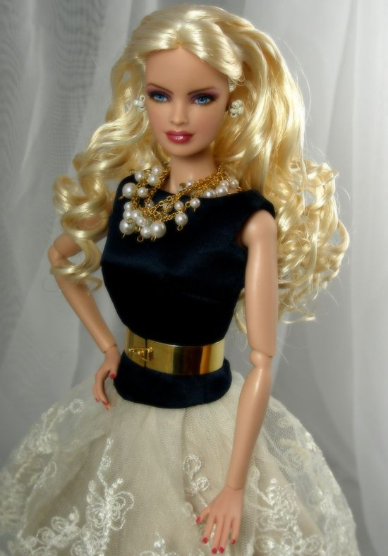Barbie channel's Chanel in black, ivory, gold and pearls