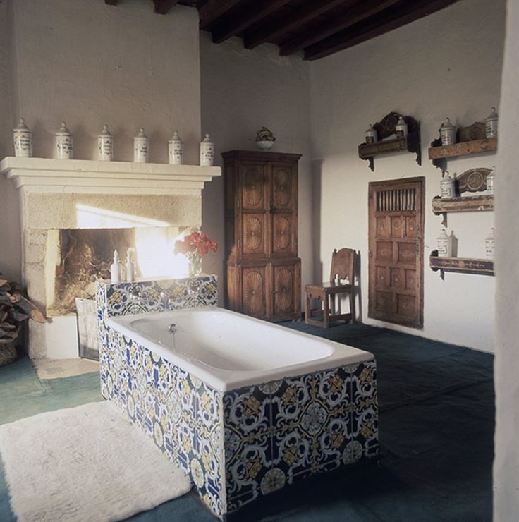 The large tile bathtub and grand fireplace in the home of the Condesa de Romanones in Extremadura, Spain.