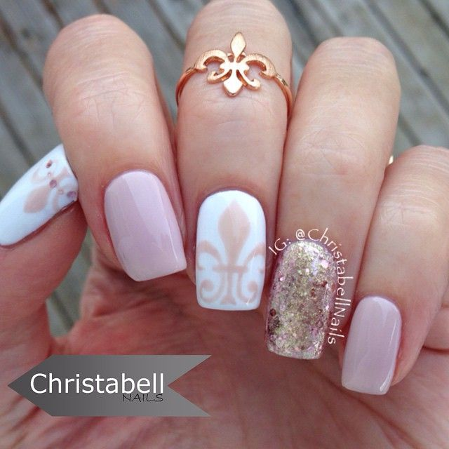 Christabell @christabellnails Instagram photos | A little Fleur de Lis to start off your Saturday #christabellnails #notd Full tutorial is on my YouTube channel Products used: @ndlacquers Naked Petals, Sinful Colors Snow Me White, and @maybelline Color Show Brocades Gilded Rose. Painted with my Pure Color Glamour brush 3 from @stylishnailartshop. ring is from http://infinitine.com