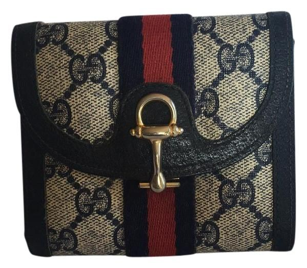 Gucci Wallet Horse Bit Clasp. Free shipping and guaranteed authenticity on Gucci Wallet Horse Bit Clasp at Tradesy. Pre-love gently carried vintage Gucci wallet made ...