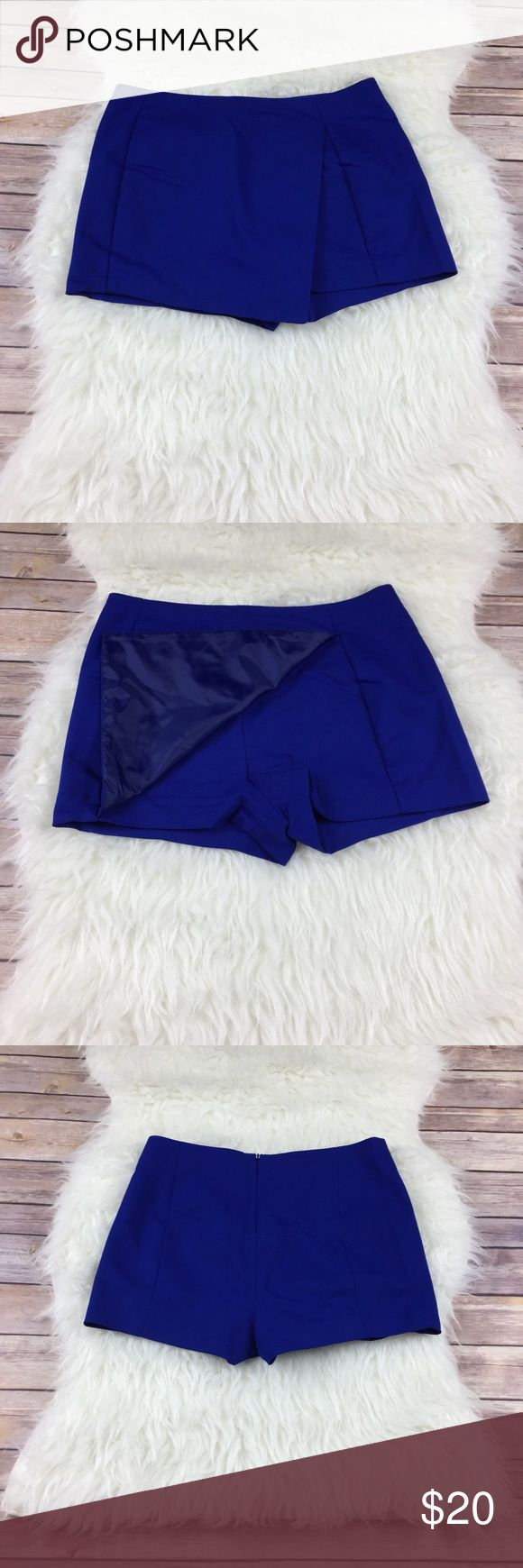 Cobalt Blue Express Skort Beautiful cobalt blue skort in EUC. Zips in the back. Has some stretch to it. No stains fading or holes. 49% Polyester 47% cotton 4% spandex Express Shorts Skorts