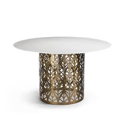 Lined up like a row of cypress trees in a Van Gogh painting, the laser-cut standing-leaf pattern decorating the sides of the Downing Dining Table is    crafted from brass-plated steel sheeting. Circular, polished-edge marble top.            Laser-cut steel sheeting                Brass-plated                Circular, polished-edge marble top                Contemporary standing leaf pattern works with ornate to transitional decor    Some assembly required