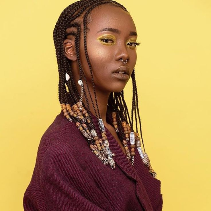 Swooning. . #braids and beads  #naturalhair  #protectivestyles  #repost . Model; @boojiea MUA ;@sk1nnyy  Hairstylist @touchedbytianaa  Stylist; @thatdarkskingirl  Photographer; @nyarko_photography  concept and creative director;@Africanjawn
