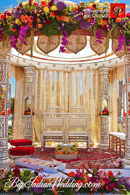 Love the top of the mandap. Reminds me of a skylight. Indian wedding decor photographed by Global Photography
