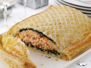 Salmon en croûte with egg, salmon, spinach, lemon juice, tarragon, salt, puff pastry dough, all purpose flour, and unsalted butter.