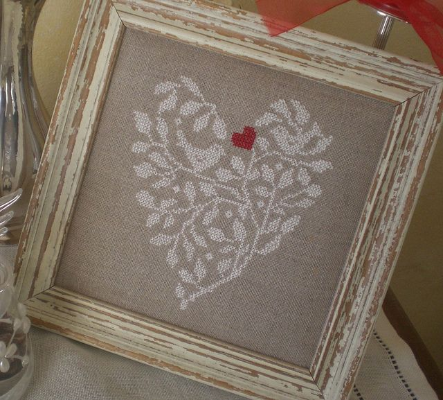 White branches and birds with red heart in a heart shape on linen.  Lovely